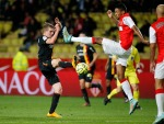 Monaco's Santos challenges Lens' Bourigeaud during their Ligue1 soccer match at Louis II stadium in Monaco